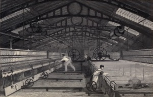 Image of the 2 mill workers atspinning jenny's with a piecer crawling underneath the machinery