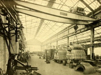 Photograph of inside of workshop with steel structure and glazed roof and walls