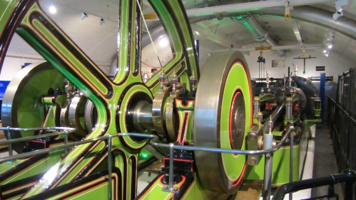 colour photograph showing the large wheel and shafts of the pumping machinery.