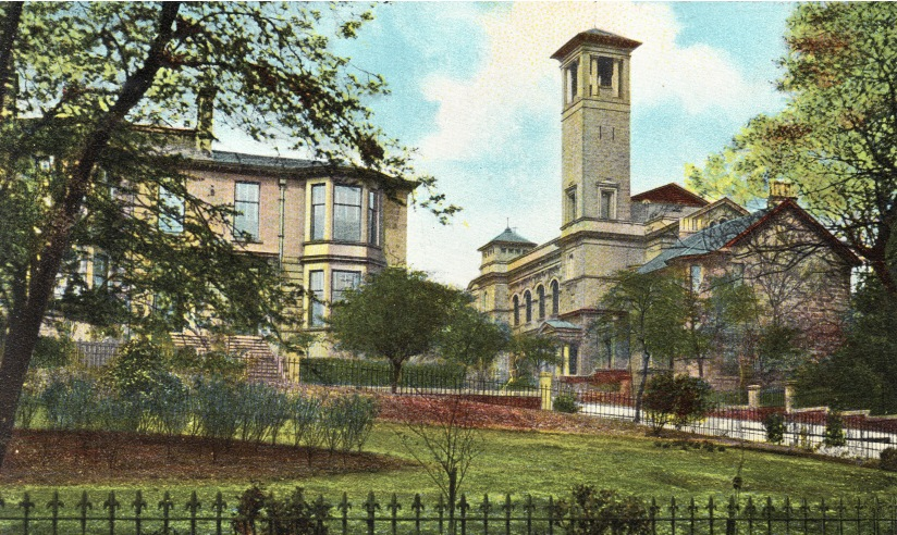 Colour postcard of the end of the terrace and church with gardens in foreground.