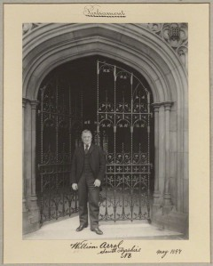 Sir William Arrol standing at gates of parliament