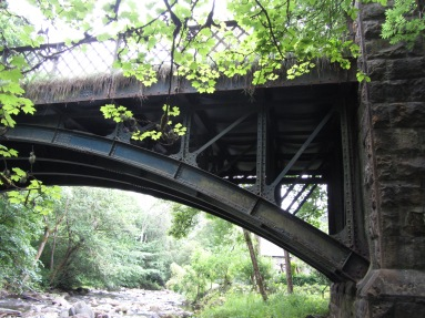 photograph showing the steelwork of the bridge showing where it joins the masonry work