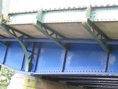 Brackets supporting footpath cantilevered from external girder