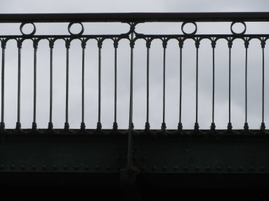 Wrought iron parapet railings with arch and circle design